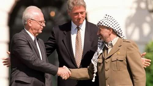 Prime minister Yitzhak Rabin and PLO Chairman Yasser Arafat with Bill Clinton